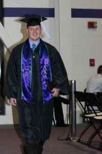 Brother Aaron Lauzon graduates, representing with his Lambda Chi Alpha sash